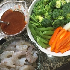 Sauce, protein and veggies are ready to cook