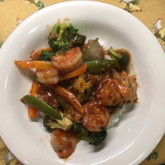 Stir fry with a side of rice is ready to eat