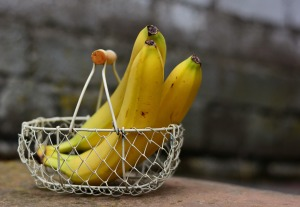 Image of three whole bananas in a wire basket