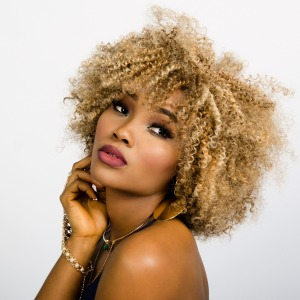 Photo of beautifully made-up curly haired model